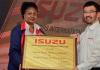 Isuzu East Africa Managing Director Rita Kavashe receives the Isuzu Service Centre Certification from the President of Isuzu Motors International Makoto Kawahara during the unveiling of the Isuzu East African Centre in Nairobi on Monday.