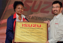 Isuzu East Africa Managing Director Rita Kavashe receives the Isuzu Service Centre Certification from the President of Isuzu Motors International Makoto Kawahara during the unveiling of the Isuzu East African Centre in Nairobi on Monday.