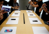 People handle the new Apple iPhone XS and iPhone XS Max during a media tour at an Apple office in Shanghai, China, September 21, 2018.
