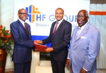 HF Group outgoing Group CEO Frank Ireri (left) hands over to the new Group Chief Executive Officer, Mr. Robert Kibaara (centre). The handover was witnessed by HF Group Chairman, Steve Mainda.