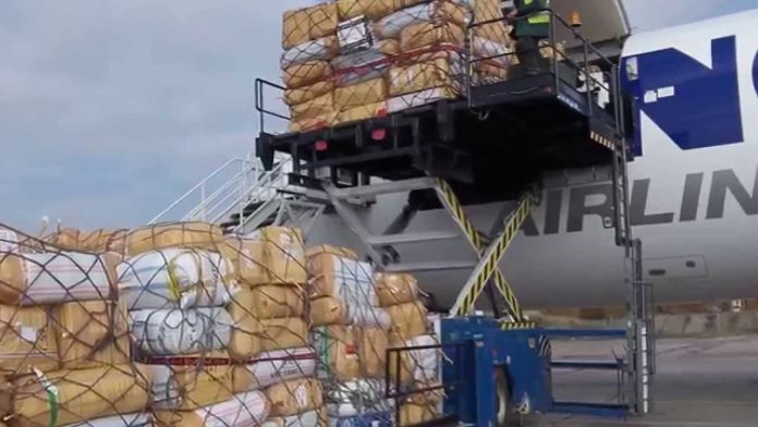 exports being loaded on to a plane