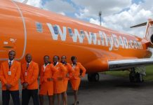 A Fly 540 airplane and staff