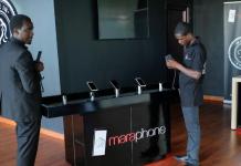 Workers display the Mara X and Mara Z smartphones during their launch by Rwanda's Mara Group in Kigali, Rwanda October 7, 2019. REUTERS/Jean Bizimana
