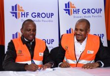 HF Group CEO Robert Kibaara (right) and Tecnofin Kenya Limited Executive Director, Robert Muchoki (left), sign a Memorandum of Understanding that will see HF Group provide end user financing and sales and marketing of 1,562 affordable housing units under development in Pangani, Nairobi. The units will retail between Ksh 1 million and Ksh 3 million and are expected to be completed in the next three years.