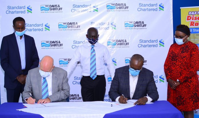 Davis and Shirtliff Group Chairman Alec Davis (left) and Standard Chartered Bank Kenya CEO Kariuki Ngari sign a partnership that will usher in Kenya's first sustainable finance package aimed at supporting individual clients' transition to cleaner technologies, harness and scale more climate friendly business practices. Looking on is Standard Chartered's Head of Sustainable Finance Africa Christopher Kirigua (left), Davis & Shirtliff Group CEO David Gatende (centre) and Standard Chartered's Head of Retail Banking Edith Chumba.