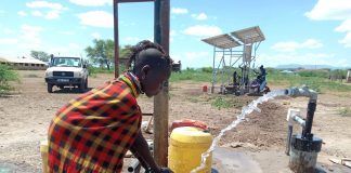 A local woman uses a Davis and Shirtliff rehabilitated borehole in Lopur Primary School, Turkana County, Kenya.