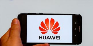 Huawei logo on a phone's display screen