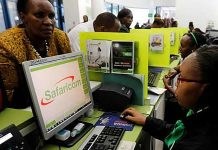 A Safaricom attendant tends to a customer.
