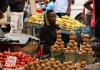 A street vendor sells vegetables in Harare, Zimbabwe, November 28, 2017.