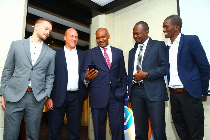 Marko Reis, Regional Manager East Africa for Infobip, Myriad Connect CEO Fabien Delanaud, HF Group CEO Robert Kibaara, Wayawaya CEO Teddy Ogallo and Kocela CEO, Abel Masai at the launch of HF Whizz WhatsApp Banking. HF becomes the first bank to commercially go live with the product.