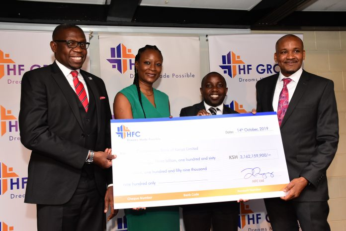 Left to Right: NSE CEO Geoffrey Odundo, MTC Trust & Corporate Services MD Bukola Awasika, Co-op Bank Head of Custody & Registrar Services Eden Kaberere and HF Group CEO Robert Kibaara. HF Group announced the full redemption of Tranche II of the Ksh 3 billion corporate bond under the Medium Term Note.