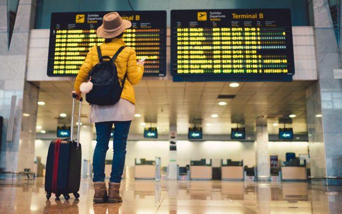 A traveler at an airport/ tourism