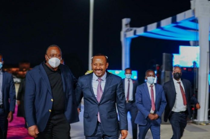 President Uhuru Kenyatta of Kenya (front left) cracks a joke with Ethiopia Prime Minister Abiy Ahmed (front right) in Addis Ababa. The Kenyan president was there to witness the issuance of an operating license to Kenyan telco Safaricom by the Ethiopian government.